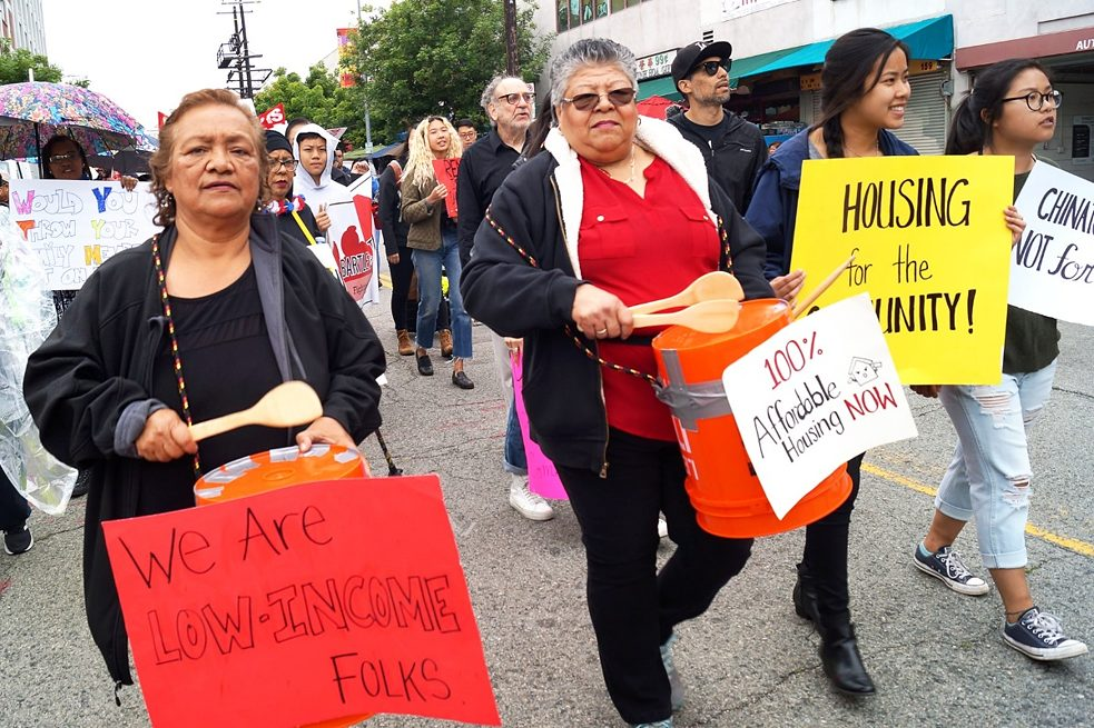 "Participants at the ""Chinatown Is Not For Sale"" march in Los Angeles, Mai 2019"