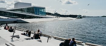 Visitors enjoying the sun at Oslo's opera.