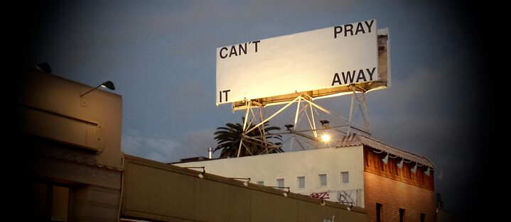"Billboard in Los Angeles with the message ""can't pray it away"""