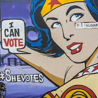 "Graffiti on house wall, woman as superhero with balloon ""I can Vote"", Brighton, England, United Kingdom"
