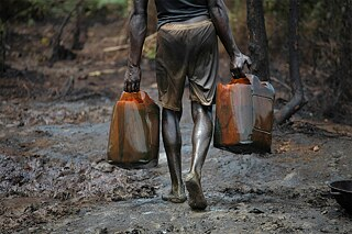 <b>Lasting environmental destruction for oil</b><br>Fuel production is another example. Subsidised by the EU, multinational energy companies have been producing oil in Nigeria's Niger Delta for decades. Western business enterprises and local elites are the top beneficiaries. A large proportion of the oil is exported to the European Union, leaving behind the environmental pollution associated with oil production and the destruction of agricultural land that deprives locals of their livelihoods and leads to poverty and disease. Every year hundreds of thousands of barrels of oil seep out of leaking pipelines, and many oil companies do not comply with Nigerian laws and promote corrupt structures.