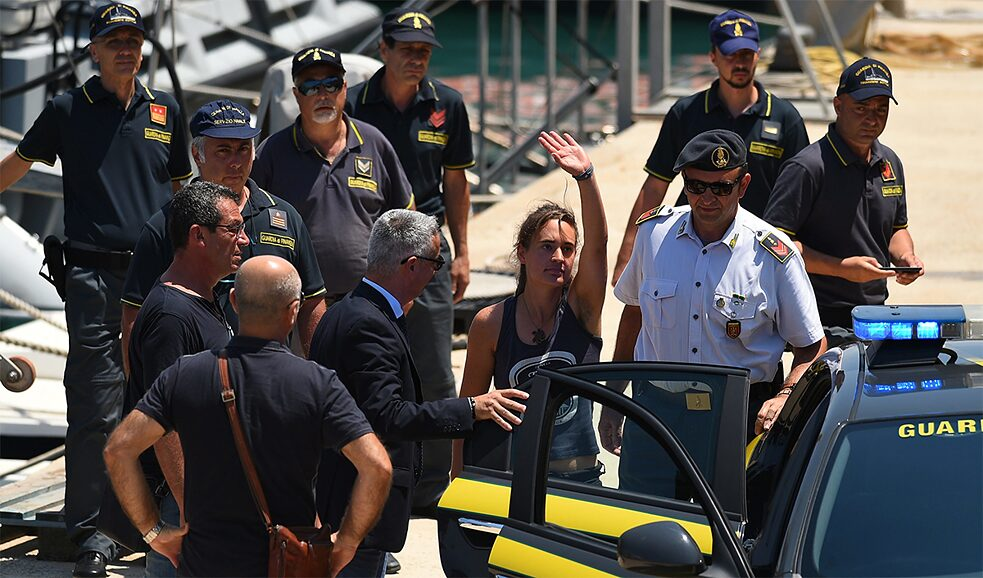Violation of Italian law, but not international law: the captain of Sea Watch 3, Carola Rackete, with Italian police officers after her arrival in Lampedusa.
