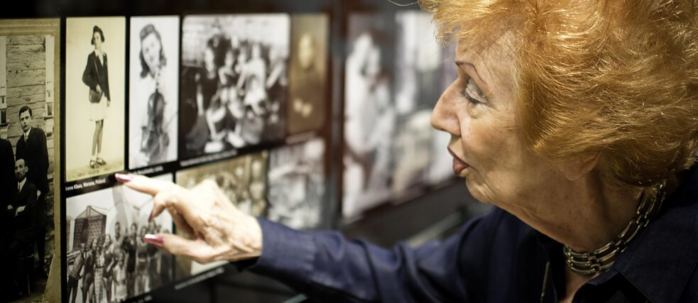 Holocaust survivor Irene Klass looking at her photograph as a young girl before the Second World War.