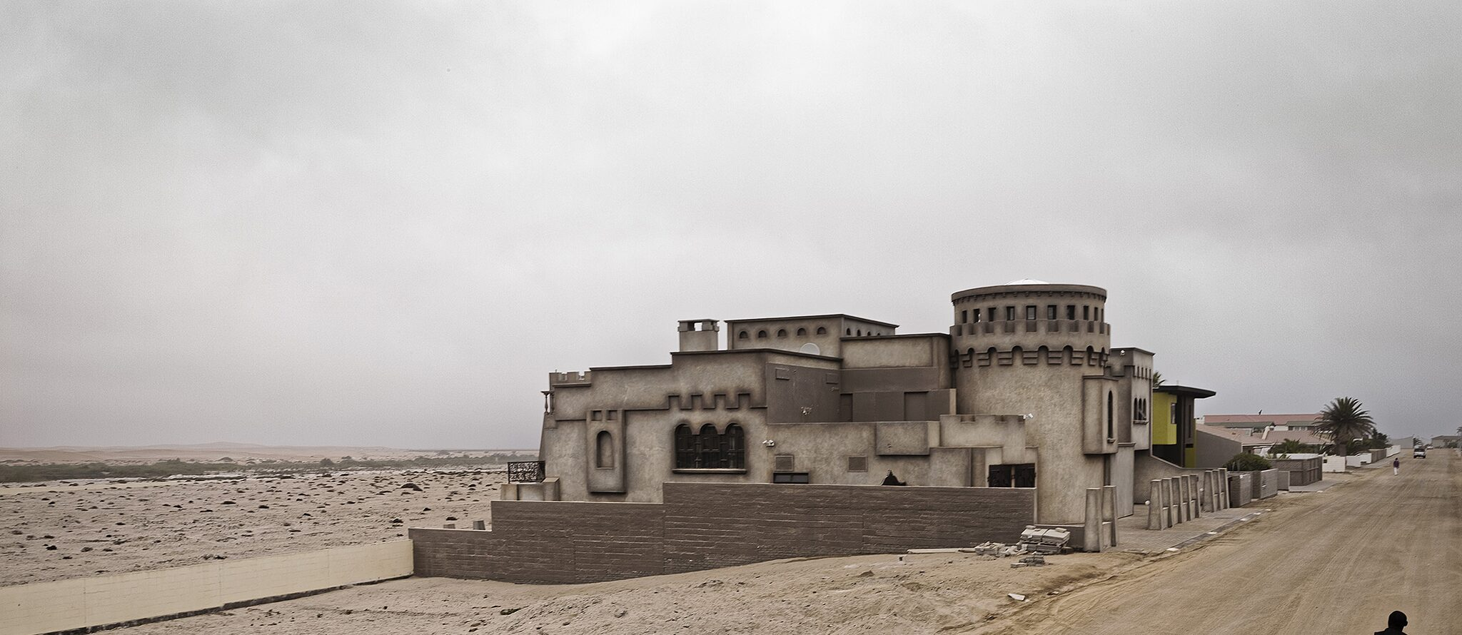 """Next to the Graves"": A private residence in Riverside Road, Swakopmund, built directly next to unidentified graves of Herero and Nama prisoners-of-war who died during the German-Namibian War and Genocide (1904-1908)."