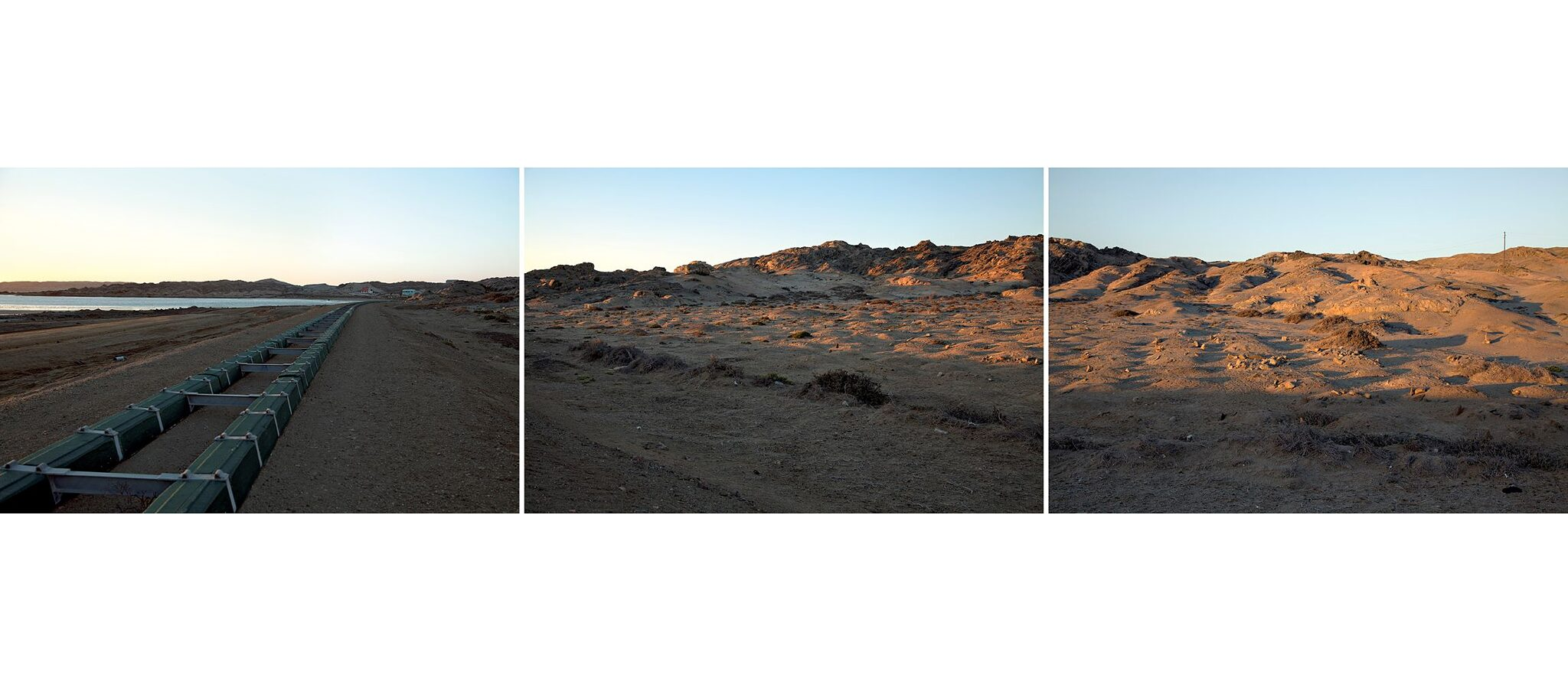 """The Earth Inside"", !Nami#Nus/Lüderitz 2013, Triptychon: These mounds mark prisoner-of-war graves outside !Nami#Nus / Lüderitz. Nama and Herero prisoners who died on Shark Island, or from exhaustion working on the railroad, were buried here. The graves lie directly next to the newly developed rail track and dirt road. They remain anonymous and unmarked."
