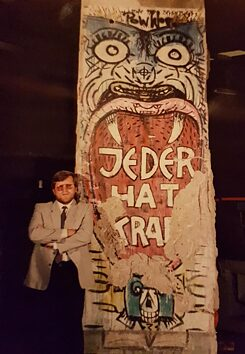Peter Kubiak with the Berlin Wall segment after it arrived in Sydney circa 1990