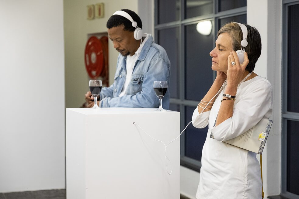 People listening to the audio section of the exhibition