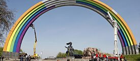 "Preparations for the Eurovision Song Contest in Kiev 2017: Workers paint the Soviet-era monument ""Arch of friendship"" in rainbow colours"