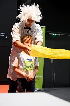 """Professor Einstein"" gets some help from a student during the live science show"