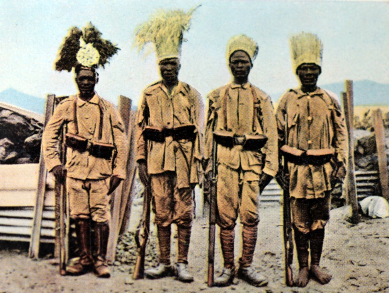 "The contemporary coloured photography from German propaganda shows Askaris - local members of the Imperial Protection Force for Deutsch-Ostafrika - in makeshift uniforms. Location and date unknown (1914-1918). The original text of the picture reads: ""Askaris in makeshift uniforms. The Lettow troops in East Africa were masters at mastering their need for weapons and equipment time and again. She created substitutes in all areas of need and lived off what she took from the enemy. It goes without saying that this gradually made the troops look very colorful."""
