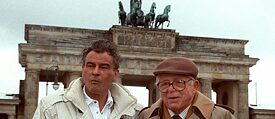 "Billy Wilder (right) and his leading actor Horst Buchholz from ""One, Two, Three"" 1993 in front of the Brandenburg Gate in Berlin"
