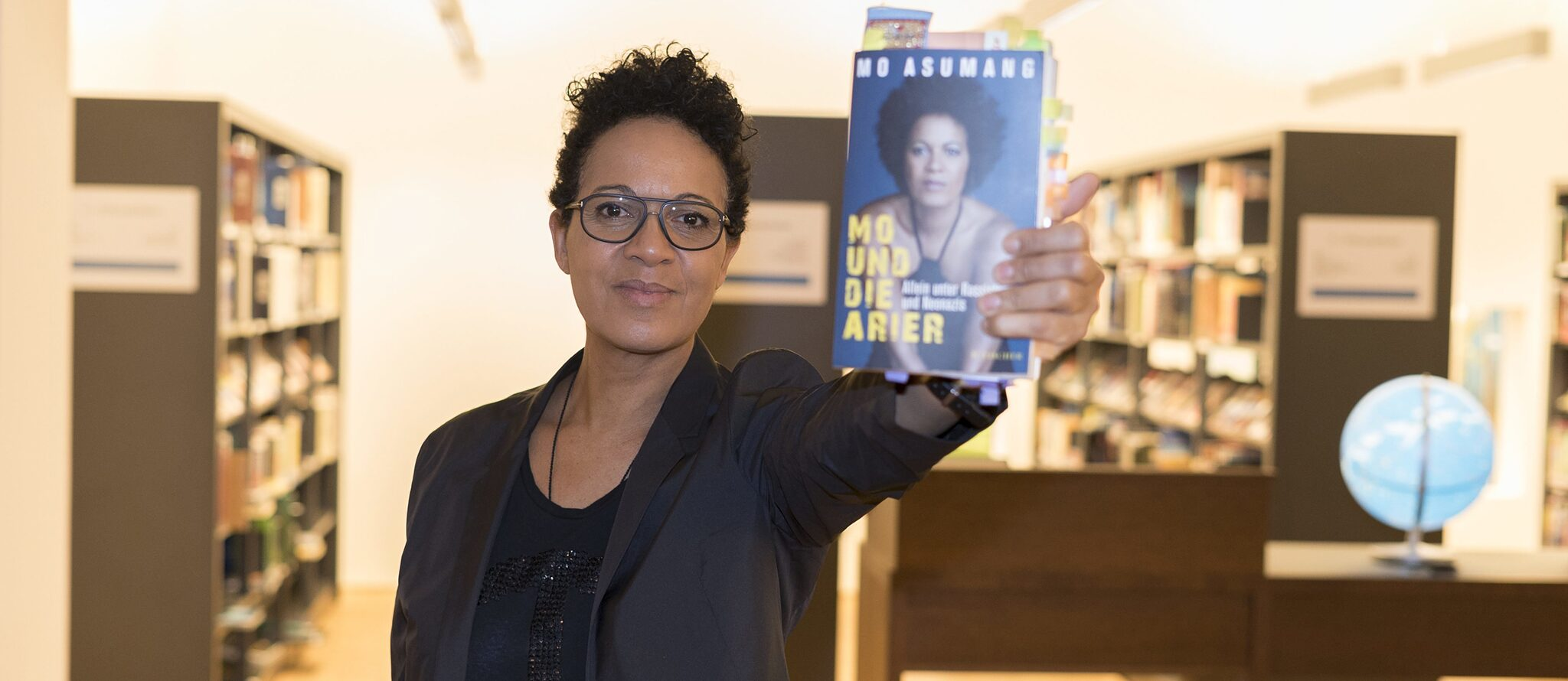 "The afrogerman writer, presenter and director Mo Asumang presents her book:""Mo and the Aryans. Alone Among Racists and Neo-Nazis"""