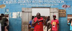 "Scene in front of the Charles Quartey Boxing Foundation from the film ""Lionhearted"""