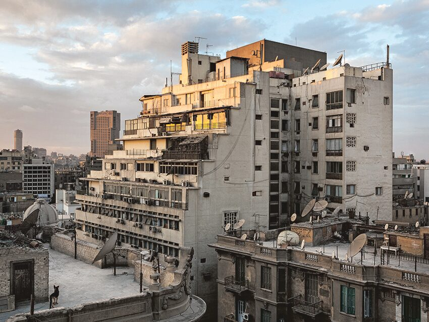 A residential building in Cairo at sunset, with a computer behind every window, suggests the countless multitudes of people online simultaneously all over the world.