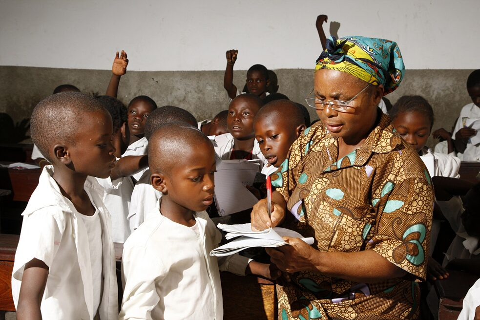 Kinshasa, Congo: Teacher and school children in class