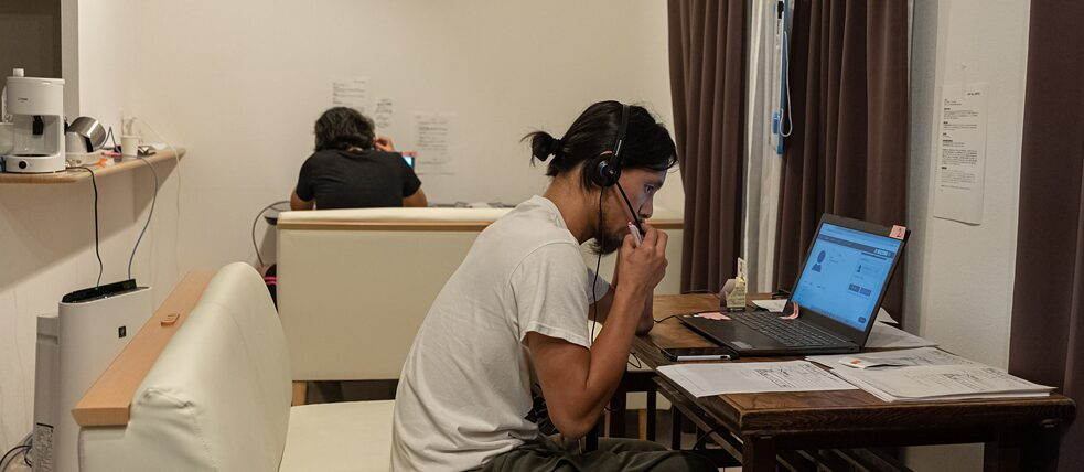 "Artists and journalists during phone calls at ""J Art Call Center""."