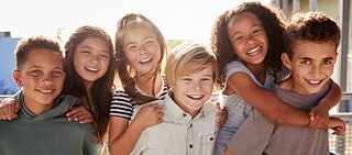 Elementary school kids smiling to camera at break time, Stock image