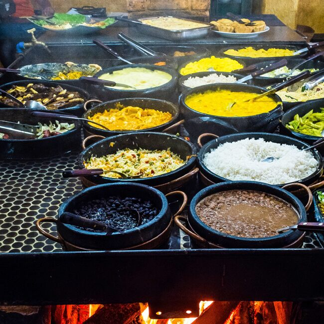 The cuisine of Bahia: multicultural diversity. Typical Bahia dishes on the stove of a restaurant kitchen in Itacare.
