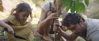 Damon, Zoe and their daughter Velvet plant a tree in their garden