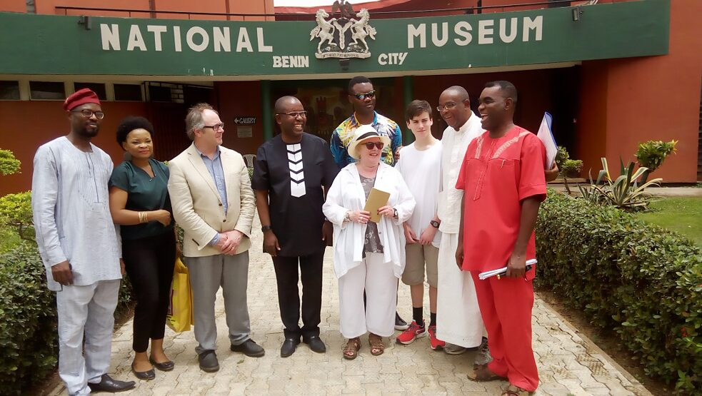 National Museum of Benin City showing the Curator at the centre with foreign and local visitor at the front of the museum on 3rd April 2018.