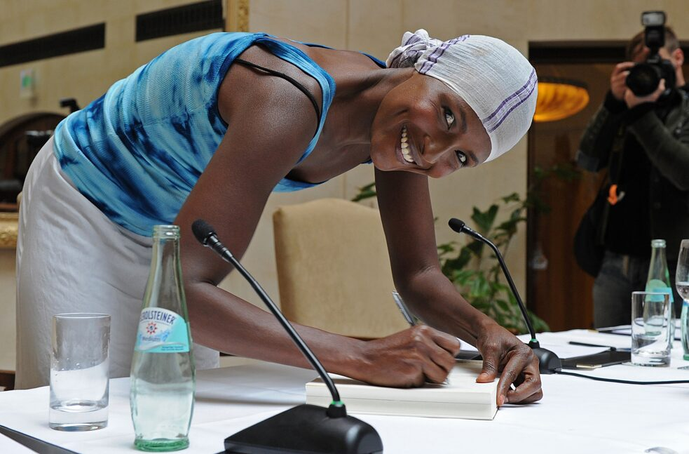 "The model Waris Dirie signs her book ""Black woman, white country"". In it she tells about her life in her new, white homeland and about her longing for Africa."