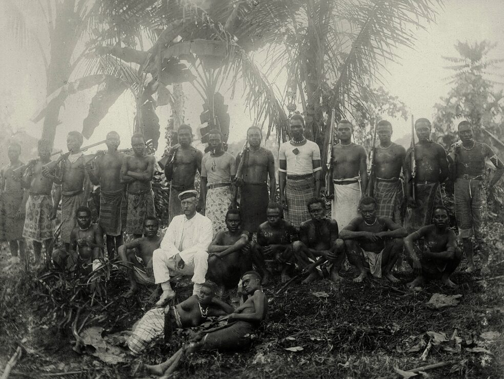 "Kaiser-Wilhelms-Land (New Guinea) as a protectorate of the German Empire 1885-1919. The Head of the German Colonial Department Hans August Lorenz Klink accompanied by a local team on an expedition. Photo, anonymous, undated (before 1897), handwritten inscription: ""Expedition Klink"". From an album with mainly ethnological photographs taken on various expeditions to the interior of Kaiser-Wilhelms-Land (Expeditions Hans August Lorenz Klink, Wilhelm Dammköhler and Ramu-Expedition of 1896), page 13. Berlin, Collection Archive for Art and History (Sammlung Archiv für Kunst und Geschichte)."
