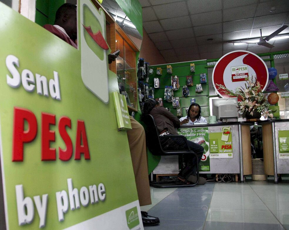 Global South: An M-Pesa mobille phone shop in Kenya's capital city Nairobi. M-PESA is mobile service provider, Safaricom's, 'mobile money', allowing users to transfer money using their mobile phone. Kenya is the first country in the world to use this service which helps users transfer small amounts of money to pay for goods and services or to send direct to relatives in villages without banks.