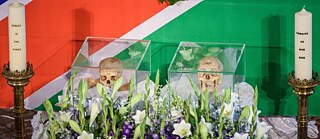 Restitution: 29.08.2018, Berlin: Bones of two victims of the genocide 1904-1908 in German Southwest Africa lie in front of the altar during a ceremony in the French Friedrichstadtkirche. At the invitation of the Protestant Church and the Council of Churches in Namibia, the mortal remains are returned during a ceremony.