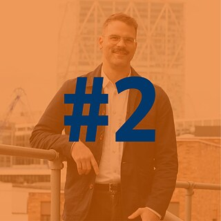 The number 2 over the photo of podcast participant Kris Nelson