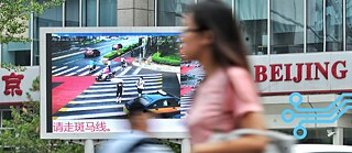 Crossing a red light: Traffic offenders in China are named and shamed.