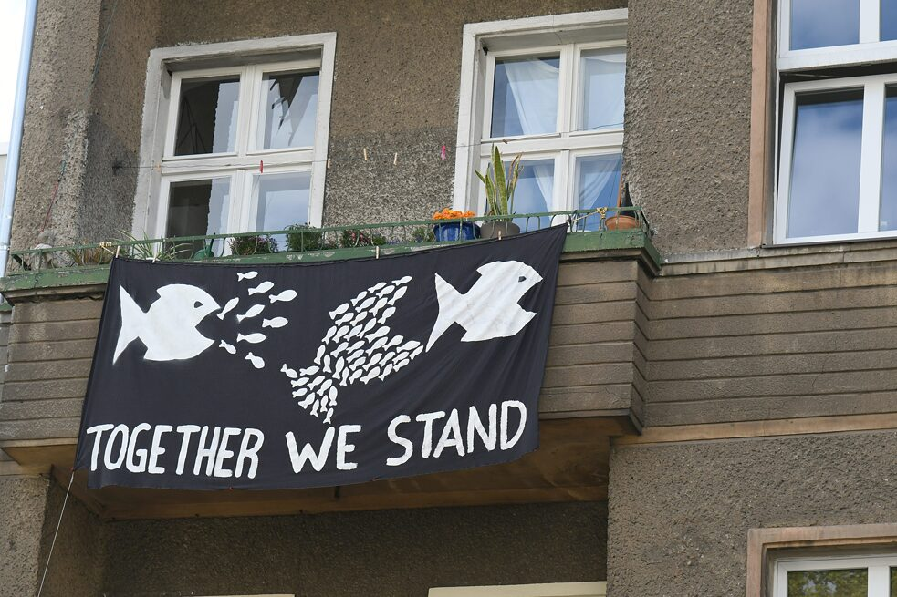 Protest banner against 'rent sharks' hangs from a Berlin apartment house.