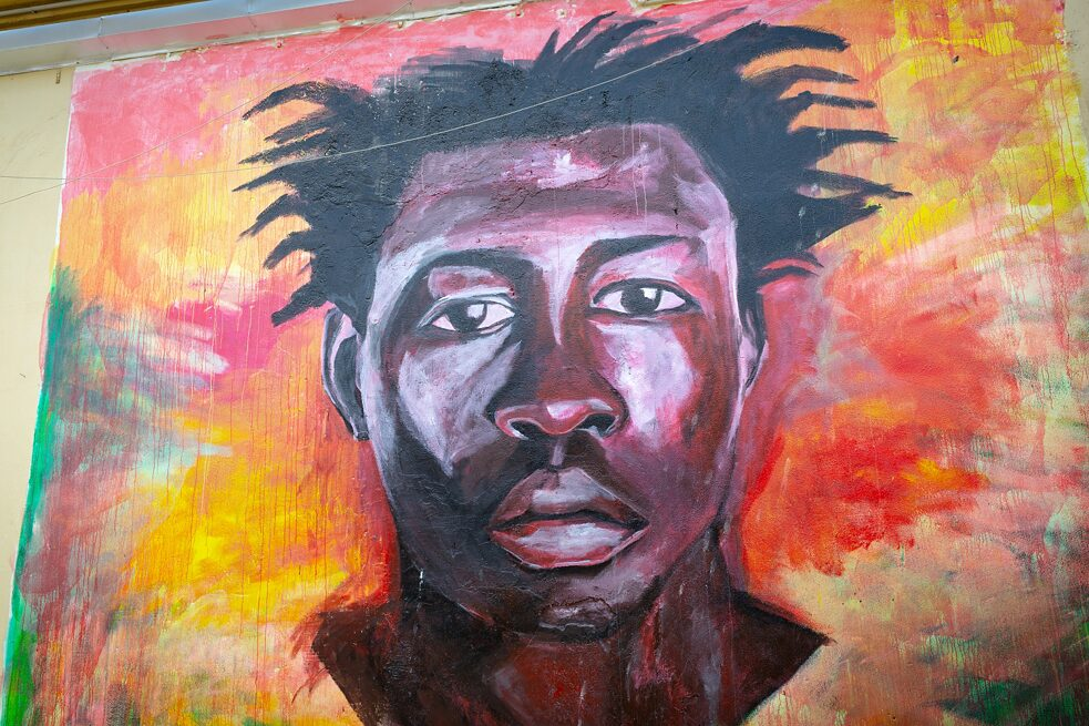 Decolonisation: Picture of the painter Mokodu Fall, his first big mural, the portrait of a young activist and field worker from Mali, Soumaila Sacko, who was shot dead aged 29 near the shantytown inhabited by African agricultural workers in Southern Italy