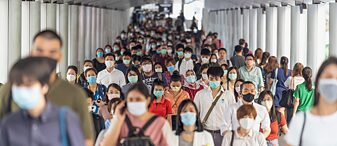 A crowd of people with masks during rush hour on March 18, 2020 in Bangkok, Thailand