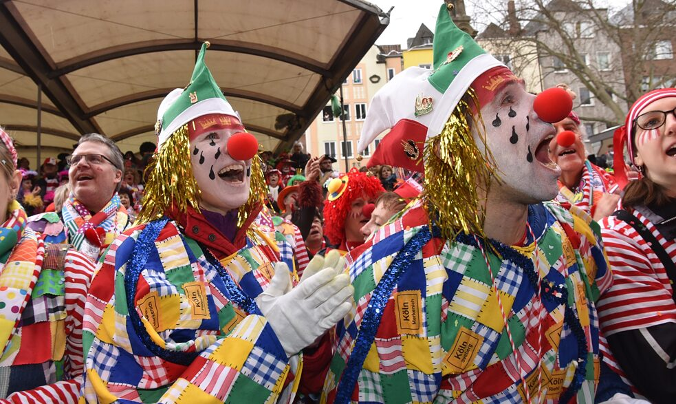 decolonial - Costumed carnivalists in front of the stage at the Alter Markt in Cologne, February 20, 2020. On Weiberfastnacht, the street carnival is traditionally opened at the Alter Markt in Cologne.