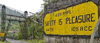 "Sign with the inscription ""Safety is pleasure"", Sangam, Arunachal Pradesh, India"