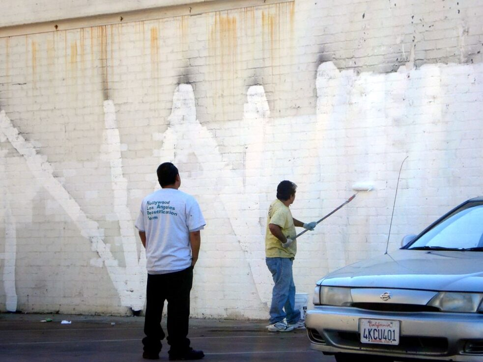 The Subconscious Art Of Graffiti Removal: City workers painting over Graffiti, blissfully unaware of their role as artists and their part in the conversation of public vs. private agency and aesthetics.