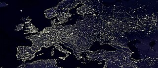 Human-made lights highlight particularly developed or populated areas of the Earth's surface, including the seaboards of Europe.