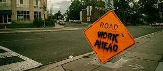 Spooky road work sign