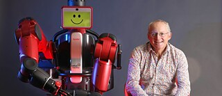 Toby Walsh with UNSW robot Baxter