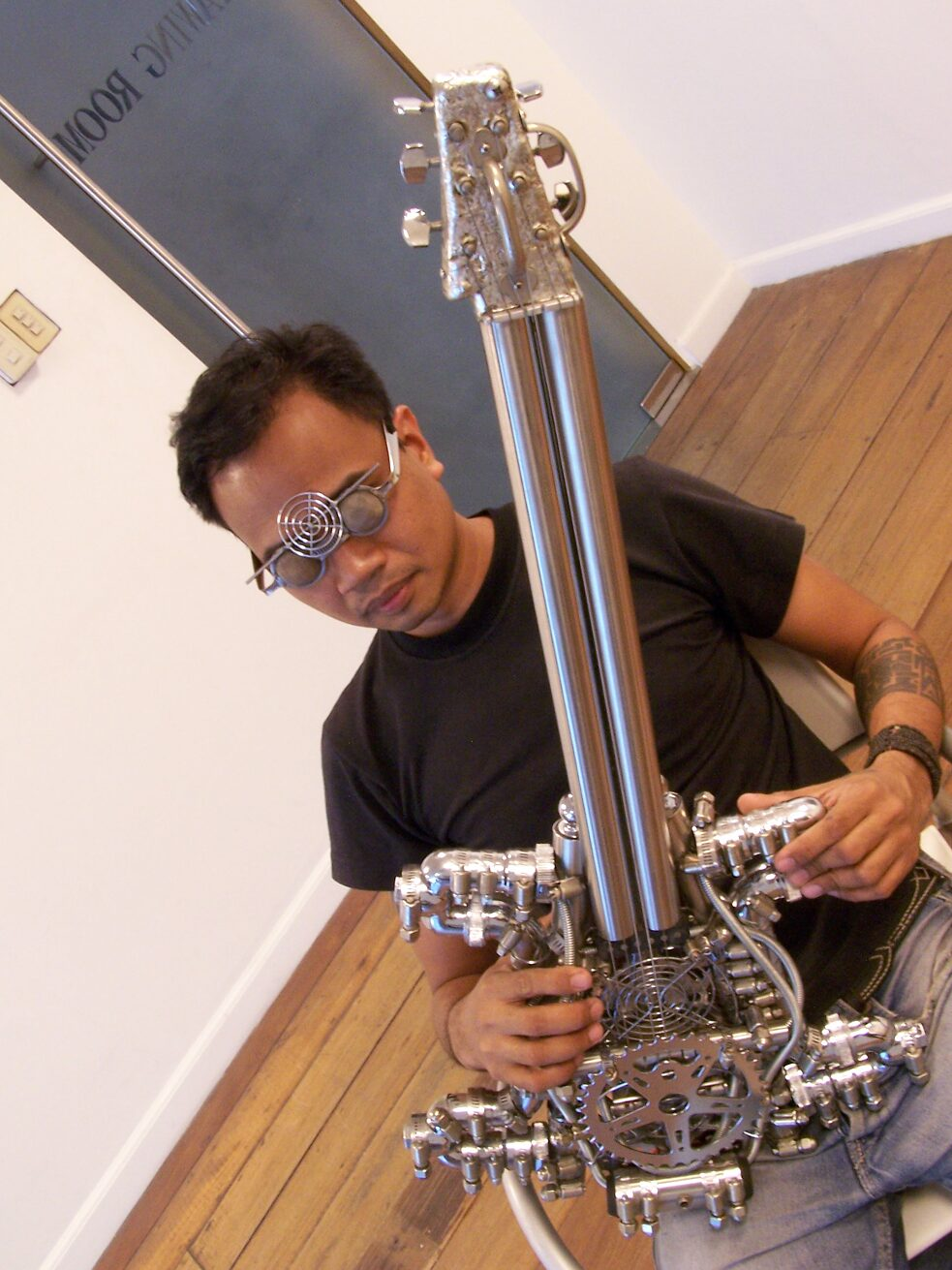 Lirio Salvador with some of his homemade devices (glasses, guitar).