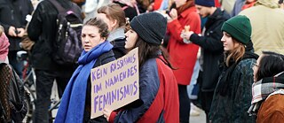"""No racism in the name of feminism"" is on the poster held up by demonstrators. The demonstration for International Women's Day took place under the motto ""Celebrate - Strike continued Fight""."
