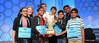 "The ""Octochamps"" of the 92nd Scripps National Spelling Bee pose with their trophy"