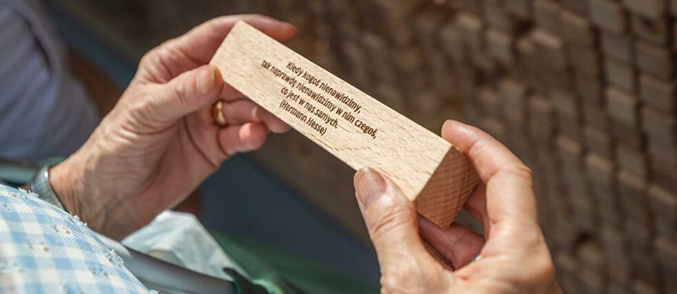 Submitted quotations from Lewis Carroll and Antoine de Saint-Exupéry on wooden blocks