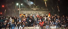 At the end of 1989, hundreds of thousands of East and West Germans celebrated New Year's Eve on the Berlin Wall at the Brandenburg Gate.