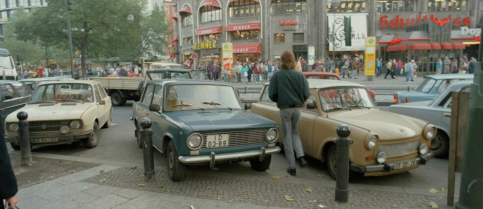 """East Germans weren't forced to conform to the West; they wanted to"": On the day after the Wall came down, thousands of East Berliners flocked to Kurfürstendamm in West Berlin (Cars from East Germany on Breitscheidplatz, 10 November 1989)."