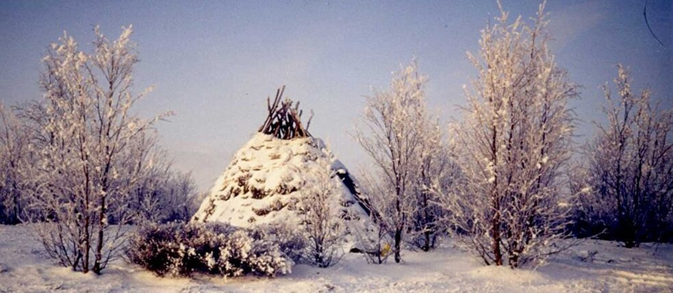 Small conical hut in the snow