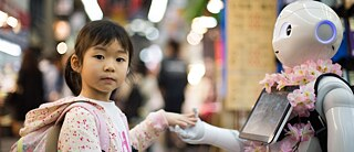 Child with robot at Kuromon Market in Osaka, Japan