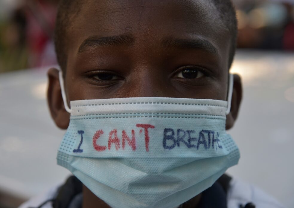 "Racism – ""I can't breathe"" is written on the mask of a boy taking part in a rally against police violence in Frankfurt."