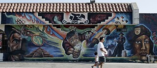 Decolonisation – File photo (19 July 2008) of a mural on Cesar Chavez Avenue in East Los Angeles named Raza Adelante, including the image of Cesar Chavez (centre).