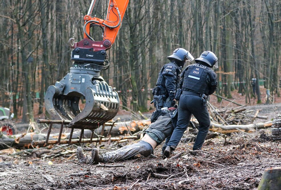 An environmental protester is removed by police from Dannenröder Forest in Germany